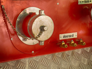 Back of a fire truck . Dials and controls.