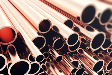 Heap of shiny copper pipes with selective focus effect. 3d rendering