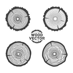 Set of four black isolated vector tree rings background and saw.