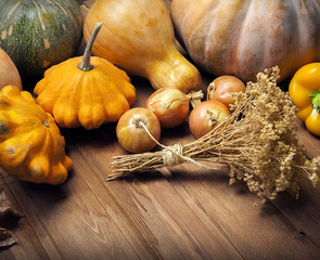 autumn pumpkins and other fruits and vegetables on wooden thanks