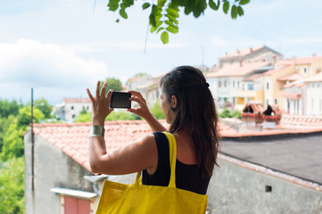 tourist taking photo with a smartphone