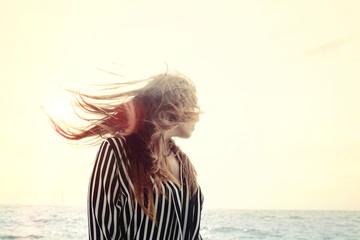 happy beautiful young woman shaking hair