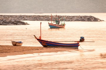 Boat on the beach at sunrise time, Long-tail boat,Boat fishermen