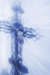 the crucifixion of Jesus Christ (statue in snow and fog)