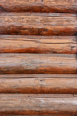 the texture of the wooden log wall of log house