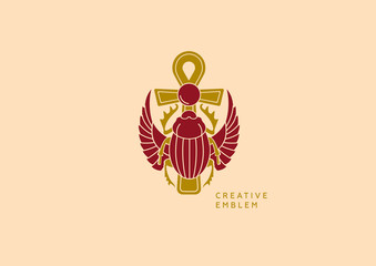 Creative emblem on Egyptian scarab with wings and a cross
