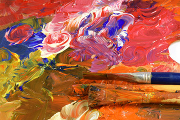 Brushes on colorful palette