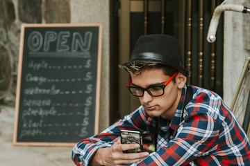 young man with mobile phone in your business