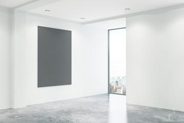 Concrete office with empty blackboard