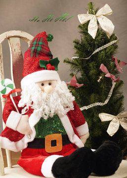 stuffed stanta on child's chair with christmas tree