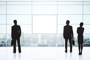 Businesspeople silhouettes and blank poster