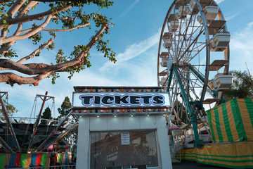 aged and worn vintage photo of ticket booth and carnival ride