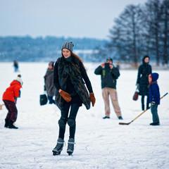 Young girl ice skating at rink in Trakai Lithuania