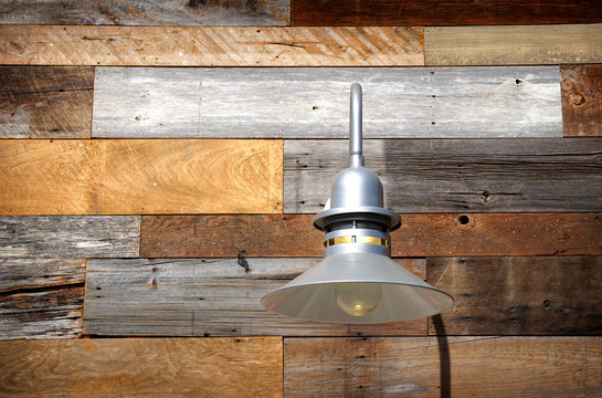 modern lamp and wooden wall decor