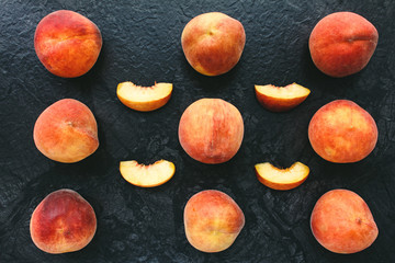 flatlay of fruits. peaches on black table