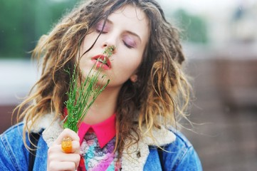 Young pretty girl with dreads with closed eyes and a tuft of gra