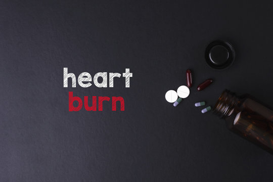Heart Burn word with medicine and bottle - Health concept. Medical concept