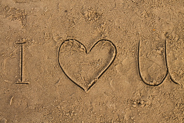 I Love U sign on the wet sand beach