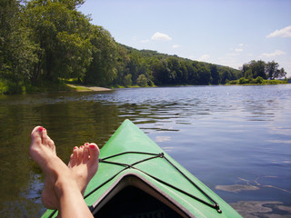 canoeing down delaware river and leisurely putting feet up