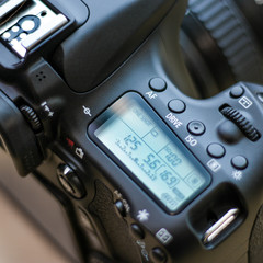Close up of DSLR camera with settings display