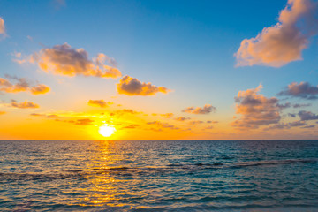 Acrylic Prints North Sea Beautiful sunset with sky over calm sea in tropical Maldives is