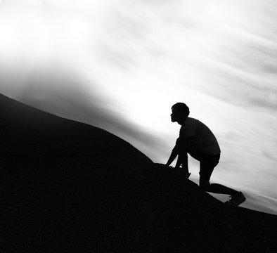 Black and white, Silhouette of man climbing mountain