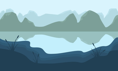 Scenery mountain and lake of silhouette