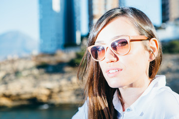 Girl with sunglasses in sunlight