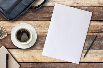 home business desk with coffee cup, notebook and paper on wooden table. empty space for text