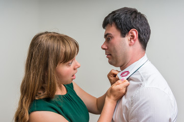 Aggressive wife revealed red lipstick on shirt collar