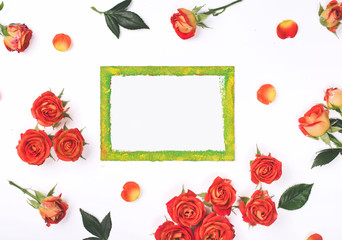 Blank card with red roses on white background