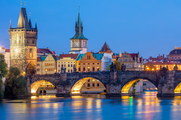 Fotobehang Praag Famous Prague Landmarks - towers and bridge at night