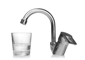 Glass of water and tap isolated on white. Water saving concept