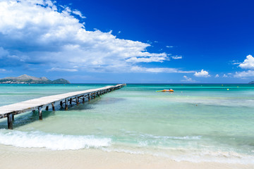 Pier at Playa Muro - beautiful beach on Mallorca, balearic island of spain