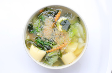 Thai style Seaweed soup with Bean Curd , mixed vegetable, Tofu  in white bowl on white background. Vegetarian Food, Healthy food, Thai food