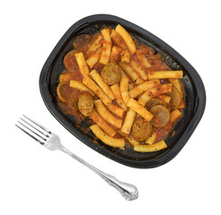 Rigatoni pasta with meatballs and sausage TV dinner plus fork.