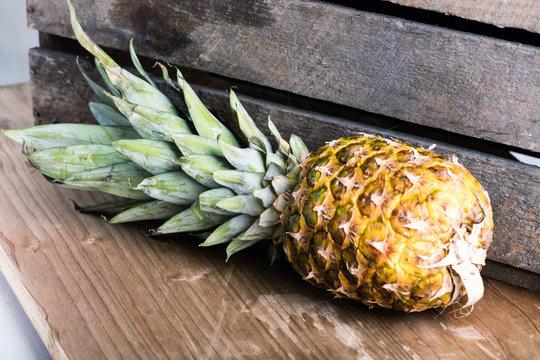 Fresh juicy pineapple on wooden board