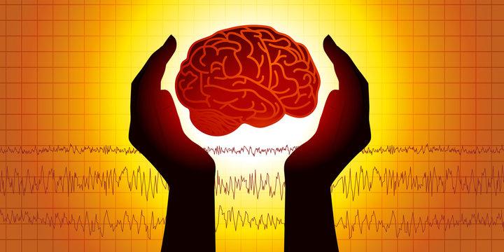 Concept de la médecine cérébrale avec deux mains protégeant symboliquement un cerveau devant un électroencéphalogramme.