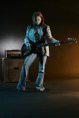 bass playing girl and amplifier