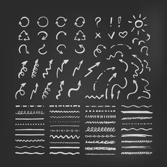 Set of vector brushes and arrows on blackboard. Chalk vector doodle brushes