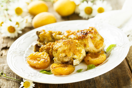 Chicken legs baked with apricots