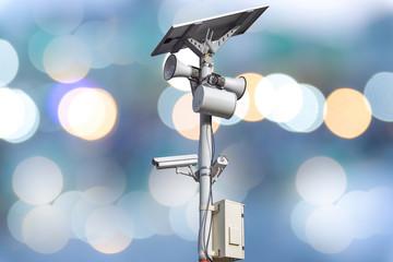 Closeup CCTV camera on colorful lighting background.