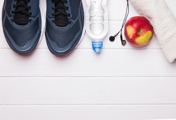 Fitness or running stuff on white wooden background