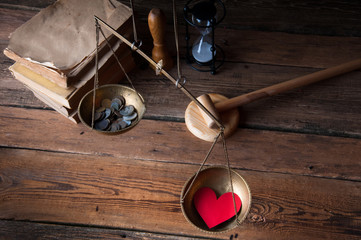 Old fashioned scale showing the advantage of love over money