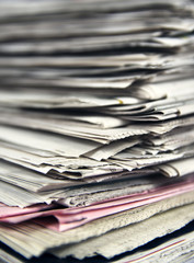 Stacked newspapers close up