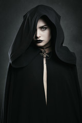 Beautiful vampire woman with black cloak