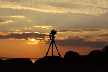 Photo camera on tripod