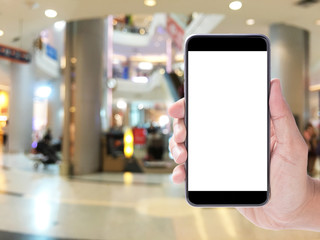 hand hold smartphone,blurred background of market