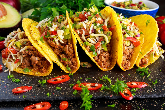 Mexican food - delicious taco shells with ground beef and home made salsa