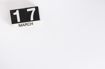 Happy St Patricks Days save the date. March 17th. Day 17 of month, wooden color calendar on white background. Spring time, empty space for text